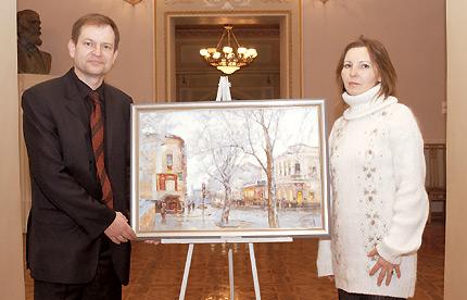 Вдарунок Представництву «Берінгер Інгельхайм» В. Сафіна передає картину «Надвечір'я», де зображено аптеку, з якою співпрацює компанія